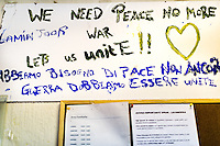 "A grafitti at Tor Sapienza refugee center in the outskirts of Rom: we need peace, no more war. Let´s unite""how immigrants are still trying to set up a new life. The center for inmigrants who claim the right to political asylum was attacked by an angry mob last November 2014."
