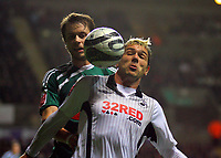 ATTENTION SPORTS PICTURE DESK<br /> Pictured: Gorka Pintado of Swansea (R) battlibg for the ball against a Plymouth Argyle player<br /> Re: Coca Cola Championship, Swansea City Football Club v Plymouth Argyle at the Liberty Stadium, Swansea, south Wales. Tuesday 08 December 2009