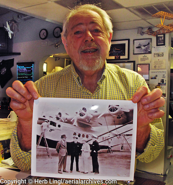 29ner Diner owner Dan Kelly displays a prize print of a China Clipper.