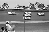 A fan watches the action, 1979 Firecracker 400 NASCAR race, Daytona International Speedway, Daytona Beach, FL, July 4, 1979.  (Photo by Brian Cleary/ www.bcpix.com )