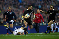 Cory Jane of New Zealand evades the tackle of Mike Brown of England during the QBE Autumn International match between England and New Zealand at Twickenham on Saturday 01 December 2012 (Photo by Rob Munro)