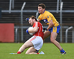 Brian O Driscoll of Cork in action against Liam Markham of Clare during their National Football League game at Cusack Park. Photograph by John Kelly.