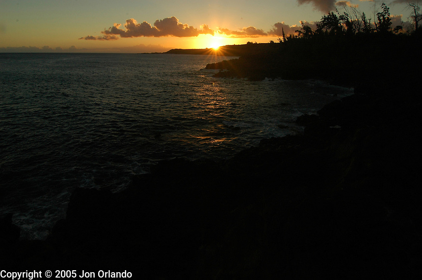 Sunset on the coast of the island of Kauai, Hawaii.