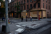 New York New York<br /> June 6, 2020<br /> <br /> After several nights of looting, nearly all ground level windows in Soho are covered with plywood. Most of the shops had been looted others are boarded for protection. <br /> <br /> At curfew hours, 8pm till 5am police cordon of certain streets and only allow residence with an ID to pass. By 8pm the streets are empty.