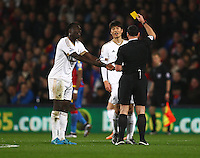 Ki Sung-yueng of Swansea is shown a yellow card   during the Barclays Premier League match between Crystal Palace and Swansea  played at Selhurst Park on 28th December 2015 in London