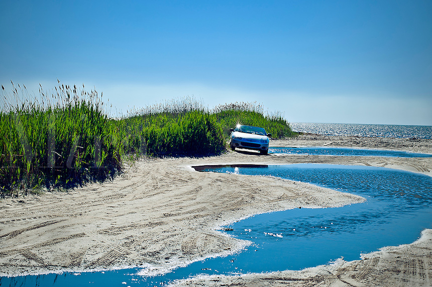 Car parked at secluded beach enterance, NJ, New Jersey, USA