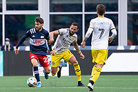 FOXBOROUGH, MA - MAY 16: Carles Gil #22 of New England Revolution breaks free of Artur #8 Columbus SC during a game between Columbus SC and New England Revolution at Gillette Stadium on May 16, 2021 in Foxborough, Massachusetts.