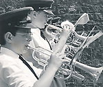 Ennis Brand Band trumpeters in parade action.