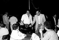 August 23, 1985 File Photo - Claude Dauphin, MNA, Lachine (L) and Robert Bourassa, Premier, Quebec (R)  attend an activity of the Quebec Liberal Party's Lachine section
