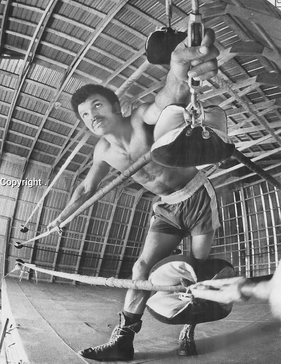 1975 FILE PHOTO -<br /> <br /> Indoors in ring which he has set up in barn in Claremont farm, Clyde Gray rests during training for June 28 world welterweight title fight against Angel Espada.