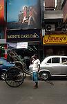 A rickshawpuller having tea in front of a Monte Carlo showroom in  Kolkata, West Bengal,  India  7/18/2007.  Arindam Mukherjee/Landov