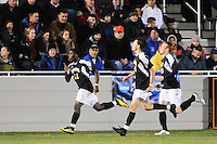 Levi Houapeu (11) of the UMBC Retrievers celebrates scoring during the first round of the 2010 NCAA Division 1 Men's Soccer Championship against the Princeton Tigers at Roberts Stadium in Princeton, NJ, on November 18, 2010.