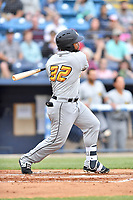 West Virginia Power first baseman Onil Pena (32) swings at a pitch during a game against the Asheville Tourists at McCormick Field on April 18, 2019 in Asheville, North Carolina. The Power defeated the Tourists 12-7. (Tony Farlow/Four Seam Images)