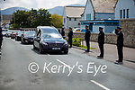 Assistant Commissioner Michael Finn salutes the hearse of the late Garda Paudie Twohig at his guard of honour by his Garda colleagues in Killarney on Tuesday.