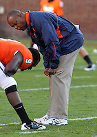 Oct 23, 2010; Charlottesville, VA, USA;  Virginia head coach Mike London talks with Virginia Cavaliers wide receiver James Valeiras (9) before the game against the Eastern Michigan Eagles at Scott Stadium.  Mandatory Credit: Andrew Shurtleff