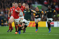 Willie le Roux of South Africa leaves the Welsh forwards in his wake during Match 41 of the Rugby World Cup 2015 between South Africa and Wales - 17/10/2015 - Twickenham Stadium, London<br /> Mandatory Credit: Rob Munro/Stewart Communications