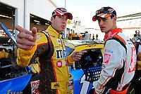 Feb 07, 2009; Daytona Beach, FL, USA; NASCAR Sprint Cup Series driver Kyle Busch (left) talks with teammate Joey Logano during practice for the Daytona 500 at Daytona International Speedway. Mandatory Credit: Mark J. Rebilas-