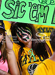 Baylor Bears fans watch the action during the game between the Iowa State Cyclones and the Baylor Bears at the Floyd Casey Stadium in Waco, Texas. Baylor defeats Iowa State 49 to 26.