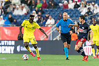 FOXBOROUGH, MA - AUGUST 4: C.J. Sapong #17 of Nashville SC dribbles at midfield during a game between Nashville SC and New England Revolution at Gillette Stadium on August 4, 2021 in Foxborough, Massachusetts.
