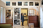 26 March 2013, Mumbai, INDIA:  Photographer Dayanita Singh in the doorway between her office space and archive room at her premises in the New Delhi suburb of Vasant Vihar. Singh is preparing to participate in the Venice Biennial with a digital slideshow go her archive of photographs in the German Pavilion at Venice. PIcture by Graham Crouch