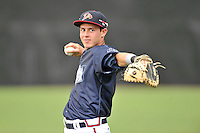 Catcher Collin Yelich (12) of the Danville Braves warms up before in a game against the Johnson City Cardinals on Friday, July 1, 2016, at Legion Field at Dan Daniel Memorial Park in Danville, Virginia. Johnson City won, 1-0. (Tom Priddy/Four Seam Images)