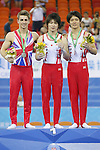 (L-R) Whitlock Max (GBR), Kohei Uchimura, Yusuke Tanaka (JPN), OCTOBER 9, 2014 - Artistic Gymnastics : 2014 World Artistic Gymnastics Championships Medal Ceremony for the Men's Individual All-Around Final at the Guangxi Gymnasium in Nanning, China. (Photo by Yusuke Nakanishi/AFLO SPORT)