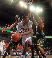 CHARLOTTESVILLE, VA- DECEMBER 6: Akil Mitchell #25 of the Virginia Cavaliers gets presssure from Mike Morrison #22 of the George Mason Patriots and Corey Edwards #13 of the George Mason Patriots during the game on December 6, 2011 at the John Paul Jones Arena in Charlottesville, Virginia. Virginia defeated George Mason 68-48. (Photo by Andrew Shurtleff/Getty Images) *** Local Caption *** Akil Mitchell;Mike Morrison;Corey Edwards