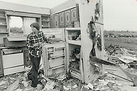 1979 FILE PHOTO - ARCHIVES -<br /> <br /> <br /> Tornado aftermath: Linda Robertson opens her fridge in what was the kitchen of her house in Oxford Centre; near Woodstock. A tornado destroyed the $65;000 home. Two people were killed and 1;000 were left homeless.<br /> <br /> Bezant, Graham<br /> Picture, 1979<br /> <br /> 1979,<br /> <br /> PHOTO : Graham Bezant - Toronto Star Archives - AQP