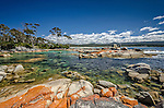 The rocky foreshore in Binalong Bay in the Bay of Fires Conservation Area on the east coast of Tasmania in Australia