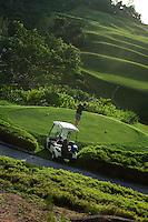 Golfer at Lemuria resort, Seychelles.