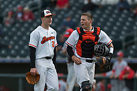 Oregon State Beavers catcher Adley Rutschman (35) and Kevin Abel (23) walk off the field between innings of a game against the New Mexico Lobos on February 15, 2019 at Surprise Stadium in Surprise, Arizona. Oregon State defeated New Mexico 6-5. (Zachary Lucy/Four Seam Images via AP)