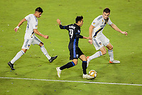 CARSON, CA - SEPTEMBER 21: Mathieu Choiniere #29 of the Montreal Impact attempts to past Joe Corona #14 and Dave Romney #4 of the Los Angeles Galaxy during a game between Montreal Impact and Los Angeles Galaxy at Dignity Health Sports Park on September 21, 2019 in Carson, California.