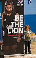 23 FEB 2014 - SMETHWICK, GBR - A young weightlifting fan prepares to practice during a break at the 2014 English Weightlifting Championships at the Harry Mitchell Leisure Centre in Smethwick, Great Britain (PHOTO COPYRIGHT © 2014 NIGEL FARROW, ALL RIGHTS RESERVED)<br /> ==========================================<br /> USE WITH CARE - IMAGE FEATURES A CHILD UNDER  16 YEARS OLD<br /> ==========================================