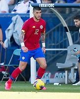 CARSON, CA - FEBRUARY 1: Ulises Segura #12 of Costa Rica turns with the ball during a game between Costa Rica and USMNT at Dignity Health Sports Park on February 1, 2020 in Carson, California.