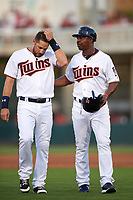 Minnesota Twins third baseman Trevor Plouffe (24) and first base coach Butch Davis in between innings during a Spring Training game against the Boston Red Sox on March 16, 2016 at Hammond Stadium in Fort Myers, Florida.  Minnesota defeated Boston 9-4.  (Mike Janes/Four Seam Images)