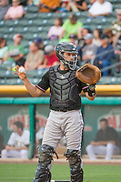 Dustin Garneau (13) of the Albuquerque Isotopes during the game against the Salt Lake Bees in Pacific Coast League action at Smith's Ballpark on June 8, 2015 in Salt Lake City, Utah.  (Stephen Smith/Four Seam Images)