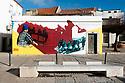 Street art depicting fishermen, Sesimbra, Portugal.