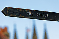 A sign for the Castle on the High Street in Totnes, England, UK. Wednesday 14 April 2021
