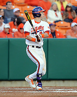 Byrnes High School product right fielder Steven Duggar (9) of the Clemson Tigers hits during a game against the William & Mary Tribe on Opening Day, Friday, February 15, 2013, at Doug Kingsmore Stadium in Clemson, South Carolina. Clemson won, 2-0. (Tom Priddy/Four Seam Images)