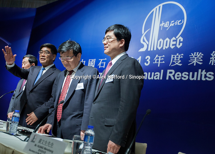 """China Petroleum & Chemical Corporation (Sinopec) Chief Financial Officer Wang Xinhua (2L), Chaiman Fu Chengyu (L), President Li Chunguang (R) and Huang Wensheng, Secretary to the Board of Directors (2R), are seen at a press conference to announce the company's annual financial results for the year ended 31 December 2013, Hong Kong, China, 24 March 2014. Sinopec, China's largest upstream refiner of oil and natural gas, announced that profits rose in 2013. The company said it recorded steady growth in 2013 despite sluggishness in the domestic and global economies. The company announced a profit attributable to equity shareholders of the company was CNY 66.1 billion (Euro 7.74 billion), up 3.5% year-on-year, with revenue up 3.4 per cent thanks to """"stable"""" domestic demand."""