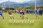 Muiris Fitzgerald for St Marys shows some of his inherited skills as he breaks from the challenges of two Dromid players.