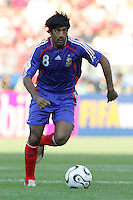 Vikash Dhorasoo of France makes a run into the Swiss box. France and Switzerland played to a 0-0 tie in their FIFA World Cup Group G match at the Gottlieb-Daimler-Stadion, Stuttgart, Germany,  June 13, 2006.