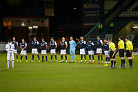 29th December 2020; Dens Park, Dundee, Scotland; Scottish Championship Football, Dundee FC versus Alloa Athletic; Dundee players observe a one minute silence before kick off in memory of former players David Sneddon, Chic McLelland and Jim McLean who all died over the Christmas period