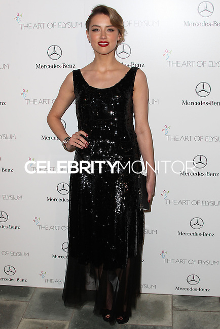 LOS ANGELES, CA - JANUARY 11: Amber Heard at The Art of Elysium's 7th Annual Heaven Gala held at Skirball Cultural Center on January 11, 2014 in Los Angeles, California. (Photo by Xavier Collin/Celebrity Monitor)