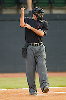 Home plate umpire Pat Hoberg makes a strike call during an Appalachian League game between the Bluefield Orioles and the Bristol White Sox at Boyce Cox Field August 27, 2010, in Bristol, Tennessee.  Photo by Brian Westerholt / Four Seam Images