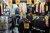Suits on sale in a tailor shop in Shinjuku, Tokyo, Japan..