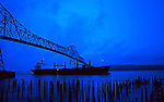 A seagoing frieghter passes under the Astoria bridge where Lewis and Clark once toiled by canoe.  Connecting Oregon and Washington.