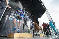 race winner: Niki Terpstra (NLD/OPQS) surprising runner up Tyler Farrar (USA/Garmin-Sharp) with a champagne shower<br /> <br /> Dwars Door Vlaanderen 2014
