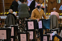 Pictured: A man carries a box full of ballot papers during the Swansea West and South West Wales Regional Election Count at Brangwyn Hall in Swansea, Wales, UK. Friday 07 May 2020