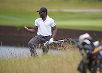 23.06.2014.  Ash, Kent, England. The Open Golf Regional Qualifier played on the International Course at The London Golf Course.  Ifeanyi Chukwu [Nigeria] in trouble in the long rough on the first hole.